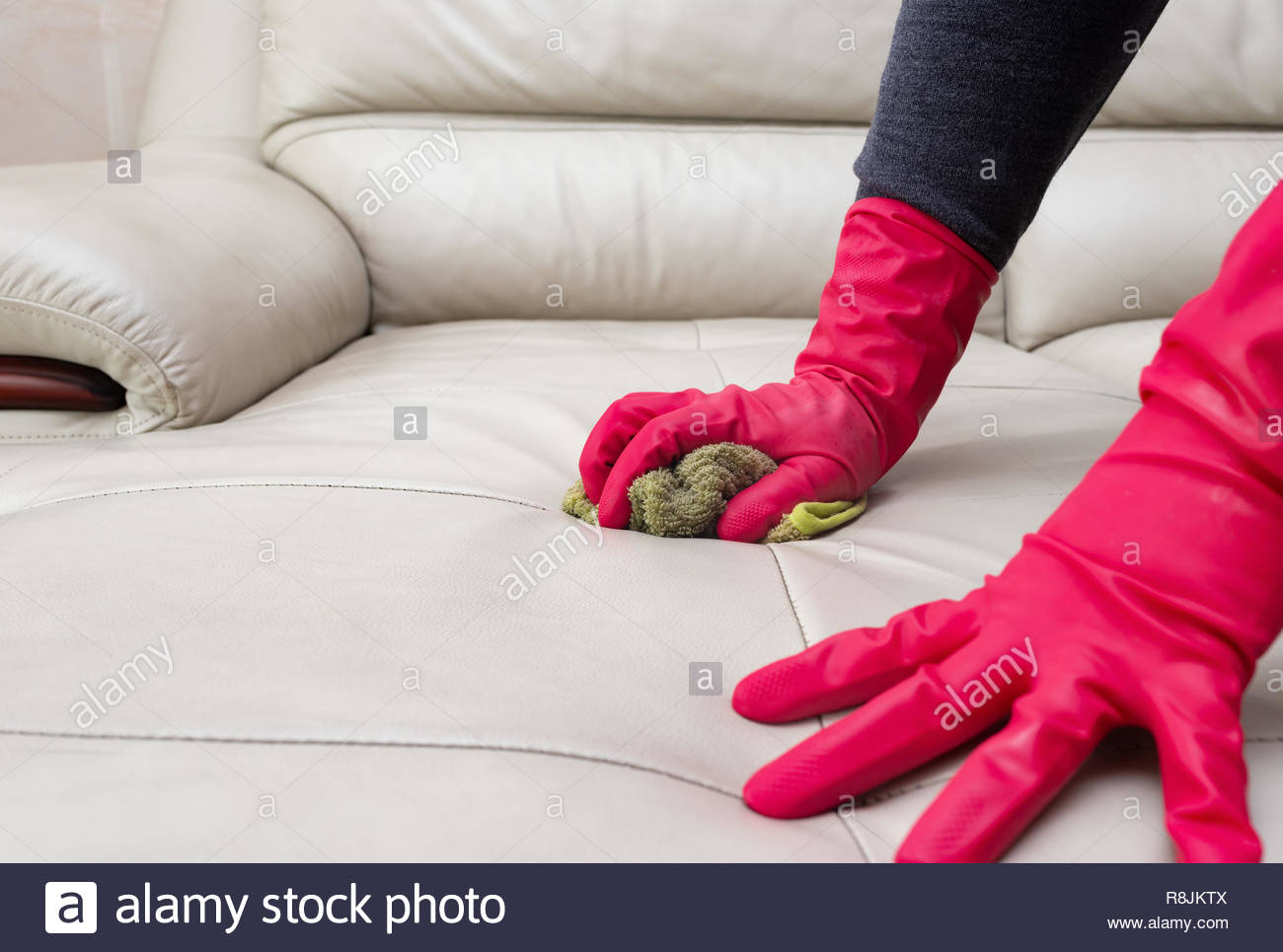 Side View Man Cleaning Leather Sofa At Home With Wet Towel regarding measurements 1300 X 965